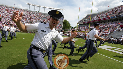 A cadet runs off the field after the conclusion of the national anthem. (Mark Umansky/TheKeyPlay.com)