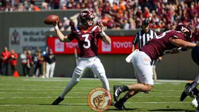 Braxton Burmeister prepares to throw the football in the first quarter. (Mark Umansky/TheKeyPlay.com)