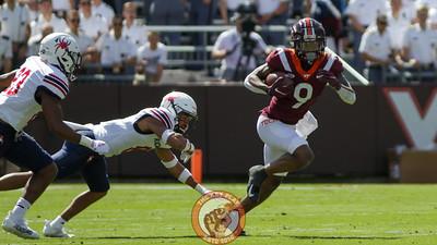 Tayvion Robinson avoids a tackle. (Mark Umansky/TheKeyPlay.com)