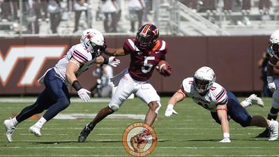 Raheem Blackshear tries to stiffarm a Richmond defender on the run. (Mark Umansky/TheKeyPlay.com)