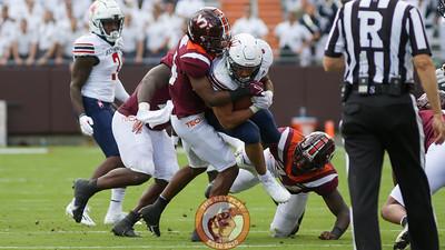 Dorian Strong attempts to tackle a Richmond player. (Mark Umansky/TheKeyPlay.com)