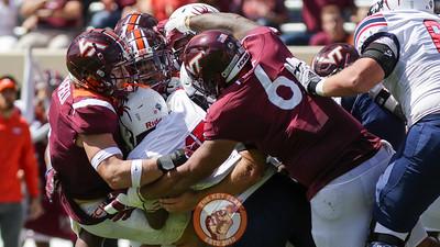 Multiple Hokie defensive players wrap up on a Richmond rushing attempt. (Mark Umansky/TheKeyPlay.com)