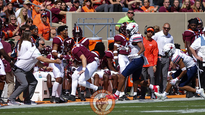 Braxton Burmeister runs out of bounds and is caught by head coach Justin Fuente. (Mark Umansky/TheKeyPlay.com)