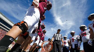 The team captains watch the coin toss. (Mark Umansky/TheKeyPlay.com)