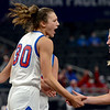 Tribune-Star/Joseph C. Garza <br /> And one: Linton's Gentry Warrick celebrates with teammate Vanessa Shafford after she was fouled while scoring during the Miners' Class 2A state championship win over Tipton on Friday in Indianapolis.