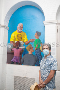 Artist Nestor Madalengoitia poses with his mural of Tree Arrington that was unveiled during the Juneteenth Celebration at the Family Partnership Center in Poughkeepsie on Saturday, June 19, 2021. HUDSON VALLEY PRESS/ Chuck Stewart, Jr.