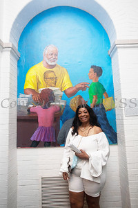 Sharon Arrington poses with the mural of her late husband, Tree Arrington that was unveiled during the Juneteenth Celebration at the Family Partnership Center in Poughkeepsie on Saturday, June 19, 2021. HUDSON VALLEY PRESS/ Chuck Stewart, Jr.