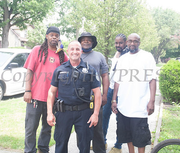 Poughkeepsie Police Officer Barbagallo with community residents during the Juneteenth Celebration in Mansion Park followed the mural dedication of Tree Arrington at the Family Partnership Center in Poughkeepsie on Saturday, June 19, 2021. HUDSON VALLEY PRESS/ Chuck Stewart, Jr.