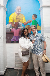 Sharon Arrington poses with the mural of her late husband, Tree Arrington, along with artist Nestor Madalengoitia, that was unveiled during the Juneteenth Celebration at the Family Partnership Center in Poughkeepsie on Saturday, June 19, 2021. HUDSON VALLEY PRESS/ Chuck Stewart, Jr.