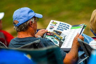 Race fan looking at a 2021 Lucas Oil Late Model Dirt Series Souvenir program