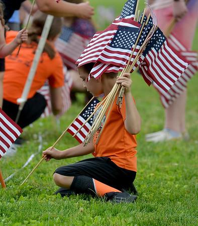 MET 052521 FLAGS LOTSA FLAGS