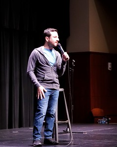 Comedian Aaron Kominos-Smith visits from New York to tell jokes involving his life experiences and chip-ins from students.