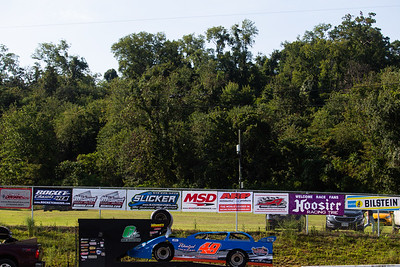 Car passing by LOLMDS pit banners