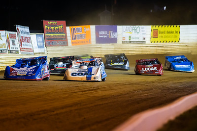 Josh Richards (14) and Andy Haus (76) lead a heat race