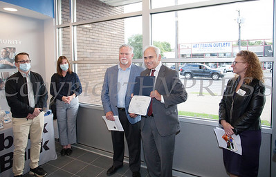 New York State Assemblyman Jonathan Jacobson presents Rhinebeck Bank President and CEO Michael J. Quinn with a certificate during the grand opening of Rhinebeck Bank in Newburgh on Wednesday, September 29, 2021. HUDSON VALLEY PRESS/ Chuck Stewart, Jr.