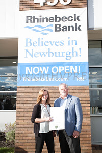 Emma Fuentes of NYS Senator James Skoufis office presents Rhinebeck Bank President and CEO Micahel J. Quinn with a certificate during the grand opening of the Newburgh branch on Wednesday, September 29, 2021. HUDSON VALLEY PRESS/ Chuck Stewart, Jr.