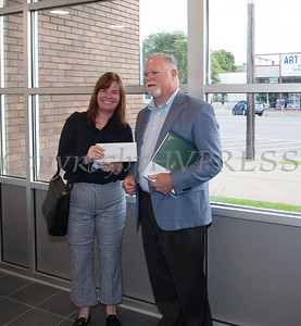 Lisa Silverstone, Executive Director of Safe Harbors of the Hudson receives a check from Rhinebeck Bank President and CEO Michael J. Quinn during the grand opening of the Newburgh branch on Wednesday, September 29, 2021. HUDSON VALLEY PRESS/ Chuck Stewart, Jr.