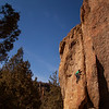 """Steven pulls upwards through """"Yoder Eaters"""" (5.10d) at the Southern Tip Wall."""