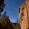 """Steven pulls into the crux on """"Yoder Eaters"""" (5.10d) at the Southern Tip Wall."""