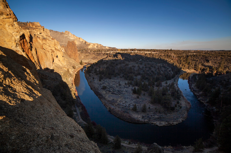 Smith Rock's main climbing walls stand out in the late evening sun over the Crooked River.