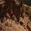 """Wes pulls through the interesting formations at the top of """"9999"""" (5.6) at the Waterfall Slab."""