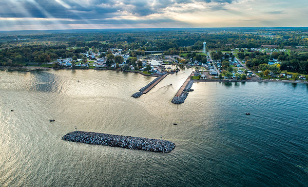 211010 Olcott Harbor <br /> James Neiss/staff photographer <br /> Olcott, NY - Anglers enjoy the quiet Sunday morning fishing on Lake Ontario at Olcott Harbor. The new breakwall is now in place as work continues along the piers.