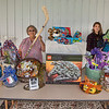 210913 Boy Scout Raffle<br /> James Neiss/staff photographer <br /> Gasport, NY - Carol Genet and her granddaughter Hanna Genet, 12, prepare items for the Confer Classic Golf Tournament basket auction. The basket auction is open to the public from 10 a.m - 4 p.m. at the Willowbrook Golf Course on Wednesday the 15th. The auction features over 100 bakekets including a Patrick Kane jersey, a $200 lottery tree, two $500 visa cards, 2 bicycles and an $800 Millennium Falcon Lego set.  All proceeds to benefit the Boys Scouts.