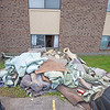 210722 LKPT Flood Follow 2<br /> James Neiss/staff photographer <br /> Lockport, NY  - Carpeting ripped out of a flooded basement apartment was tossed out the window at an apartment complex in the 6300 block of Robinson Road.