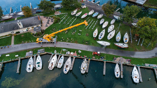 211010 End of Season 3<br /> James Neiss/staff photographer <br /> Wilson, NY - Members of the Tuscarora Yacht Club on Clark Island joined forces with a giant crane from Clark Rigging to take boats out of the water for the season in Wilson Harbor.
