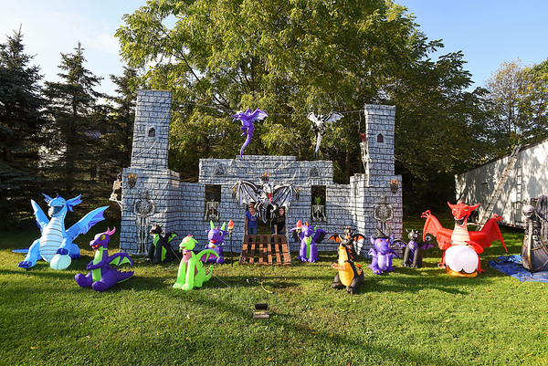 211010 Halloween Enterprise 4<br /> James Neiss/staff photographer <br /> Wrights Corners, NY - April Kubiniec, left, joined by her future daughter-in-law Kali Morley show off the new dragon castle made out of pallet wood.