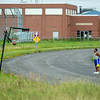 210722 Enterprise 1<br /> James Neiss/staff photographer <br /> Niagara Falls, NY - Nothing But Net - A young man playing a solo game of basketball sinks a half court shot while playing on Packard Court Thursday.