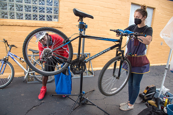 """210915 Project Connect 1<br /> James Neiss/staff photographer <br /> Niagara Falls, NY - Daniel Stewart checks out his wheel as Cindy Wood, Gobike Niagara Falls Planning Coordinator & Safety Ambassador, adjusts his bicycle during the Heart, Love & Soul Project Connect Niagara event. Project Connect Niagara is an event designed to connect those in need with critical services in a """"one-stop"""" venue. <br /> <br /> <br /> September 9, 2021<br /> FOR IMMEDIATE RELEASE<br /> Contact: Christian Hoffman<br /> E-mail: choffman@communitymissions.org <br /> Office Phone: (716) 285-3403 x. 2247<br /> Cell: (540) 460-6920<br /> Community- Non-Profit<br />  <br /> Project Connect Niagara Returns September 15<br /> Event provides wide range of services to individuals throughout Niagara County<br />  <br /> NIAGARA FALLS, N.Y. – Project Connect Niagara, an event designed to connect those in need with critical services in a """"one-stop"""" venue, will return on Wednesday, September 15 from 9 a.m. to 1 p.m. at Heart, Love, and Soul Food Pantry & Dining Room in Niagara Falls, N.Y.<br />  <br /> Project Connect Niagara aims to bridge the knowledge gap that often exists between the community resources provided by many organizations, and local residents that can benefit from these programs and services. The event is designed for attendees to engage with many of the 25+ resources on-site, including employment opportunities, social services, legal advice, and medical services.<br />  <br /> Many safety measures will be in place to protect all in attendance. Vaccinations will be available on-site, and all attendees must wear masks, which can be provided. Social distancing will be in effect, which has limited the number of agencies present for this year's event. A bagged lunch will also be provided to all attendees.<br />  <br /> In 2019, approximately 300 attendees accessed these free services and information, while 125 individuals benefited from on-site health services, referrals and resources p"""