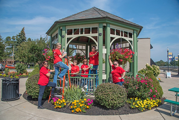 210914 Neighbors Difference<br /> James Neiss/staff photographer <br /> Lockport, NY - A volunteer team from Keybank Lockport City Branch, from left, Tina Singh, Jennifer Carr, Tina Heiman, Manager Yavonne Michaels, Laurie Mattiuzzo and Jennifer Luce get ready to paint the gazebo in the Lockport Locks Heritage Area as part of Keybank's annual Neighbors Make The Difference Day.