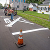 210913 RR Enterprise<br /> James Neiss/staff photographer <br /> Gasport, NY - X marks the spot - JR Rehwaldt of Rehwaldt Sealing & Stripping said this railroad crossing at the corner of Central Avenue and State Street in Gasport  is one of over 18 railroad crossings he's repainted this summer.