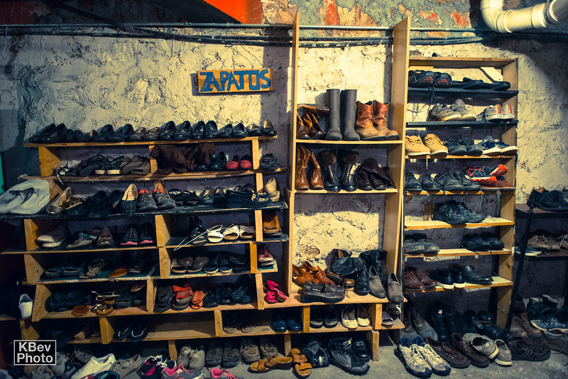 KBev: Most people think about toysfor the holidays, but I saw a lot of shoes and clothing in the basement, are there specific needs that you have for clothing or other things?<br />  <br /> Mary: In regards to clothes, we are always in need of NEW underwear and socks, tennis shoes and sandals in GOOD condition (heels and boots are not needed), and jeans of all age ranges in SMALL sizes (most of our population come from Central America, where people are generally much shorter and skinnier than the United States.<br />  <br /> We are also always in need of cleaning products (bleach, pinsol, dish soap, laundry detergent, etc) and toiletries (deodorant, razors, travel size shampoo and toothpaste, soap, toilet paper, q-tips, feminine pads, baby wipes and diapers, etc)