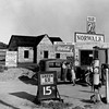 dorothea-lange-newly-built-store-and-trading-center-typical-of-new-shacktown-community[1]