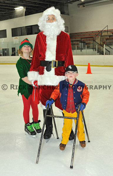 All from Orland Park<br /> L to R<br /> elf Susan Westman<br /> Santa<br /> Joey Fagen