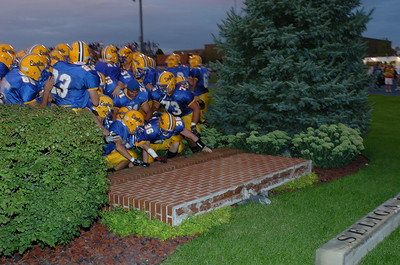 after the national anthem, the players touch the brick monument in the south endzone for luck.  As I shoot photos with my wide angle from the other side, the wall comes crashing down!  I am inches away from the 6' wall of bricks landing on me.  Bad sign for the home team.