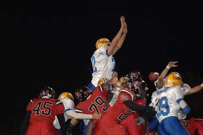 Sandburg #8 blocks the point after touchdown kick.  #72 high in the air.
