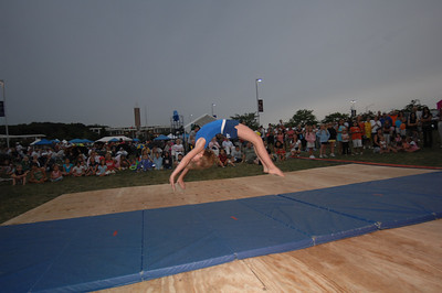 7:15pm to 8pm Village Gainers Gymnastics Main Stage Dance Floor I can get the ID of this girl, if needed.