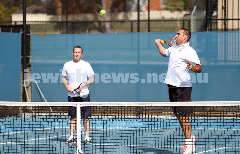 23-8-14. Maccabi tennis Grade 3 Pennant def Kooyong.  Asaf Nagar plays a shot at the net, Joel Fredman watches on. Photo: Peter Haskin