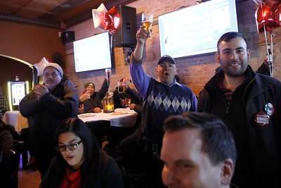 Supporters and volunteers of Lisa Hernandez cheer March 20 at V Bar in Berwyn after claiming victory.