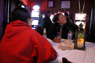 Sandra Schmidt (right), a Lisa Hernandez supporter, watches election returns March 20 at V Bar in Berwyn after claiming victory.