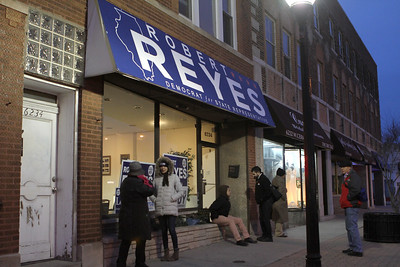 Supporters of Robert Reyes wait for the door to the campaign office to be unlocked March 20 to wait for election results.