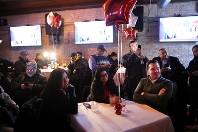 Volunteers and supporters of 24th District Illinois House Democratic incumbent Lisa Hernandez listen to her victory speech March 20 at V Bar in Berwyn after claiming victory.