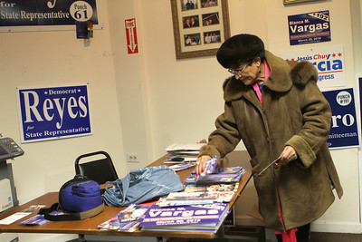 Blanca Vargas of Cicero straightens up a desk at Robert Reyes' campaign office March 20 as she and fellow supporters wait for election results.