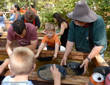 People pan for gold during the 25th annual Days of Living History   at the Gold Nugget Museum in Paradise, Calif. Saturday, Sept. 8, 2018.  (Bill Husa -- Enterprise-Record)