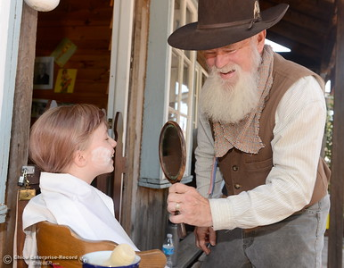 Old time Barber Ken Prentiss shows 8-year-old Andrea Christen of Paradise her face in a mirror during the 25th annual Days of Living History   at the Gold Nugget Museum in Paradise, Calif. Saturday, Sept. 8, 2018.  (Bill Husa -- Enterprise-Record)