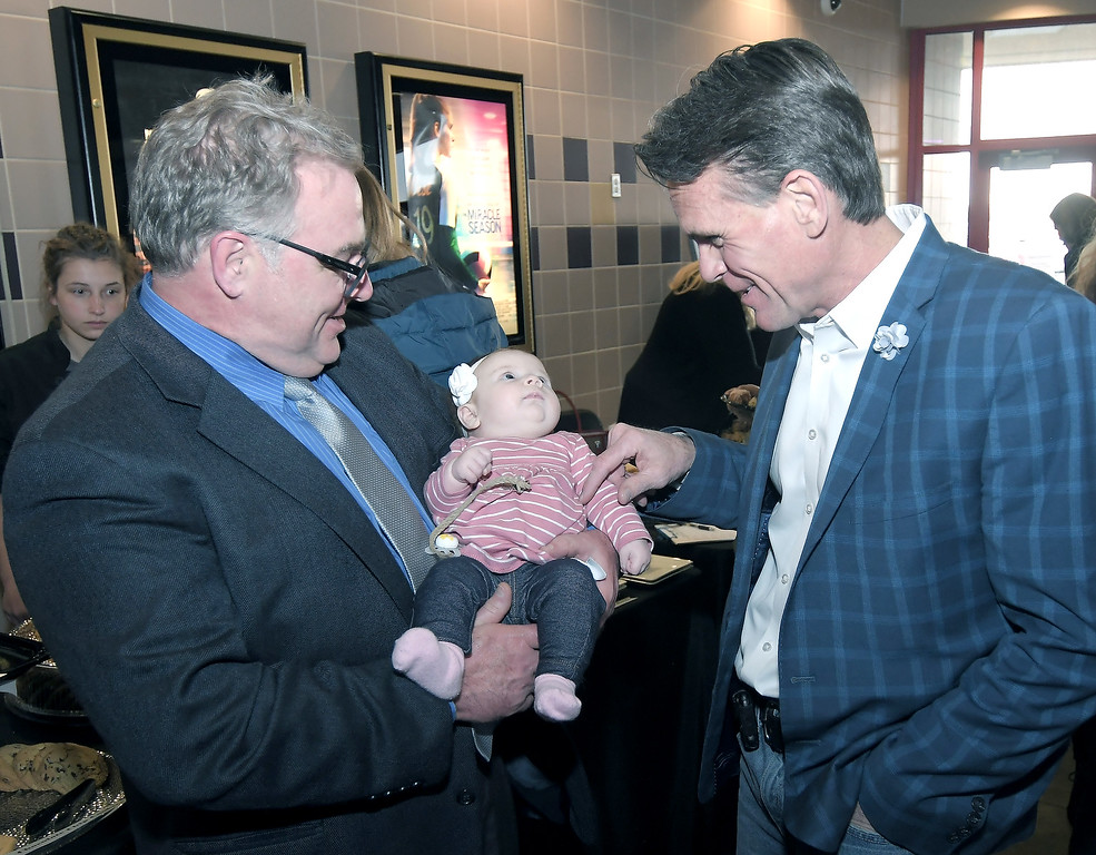 . Brendan Wagner, president of The Resolution Center Executive Board, introduces his granddaughter Cori Lynn Wagner to Macomb County Executive Mark Hackel. Photo courtesy of The Resolution Center