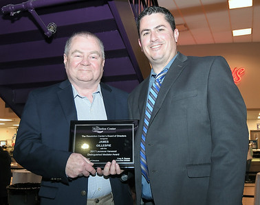 James Gillespie, left, accepts theLaurence Harwood Distinguished Mediator Award from Craig Pappas, The Resolution Center Executive Director. Photo courtesy of The Resolution Center